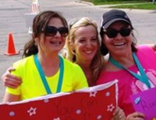 Me cheering on two of my best gf's- after their first 10K! They rocked it, of course.