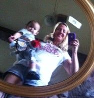 Arya and I show off the variety of mirrors we had for sale.